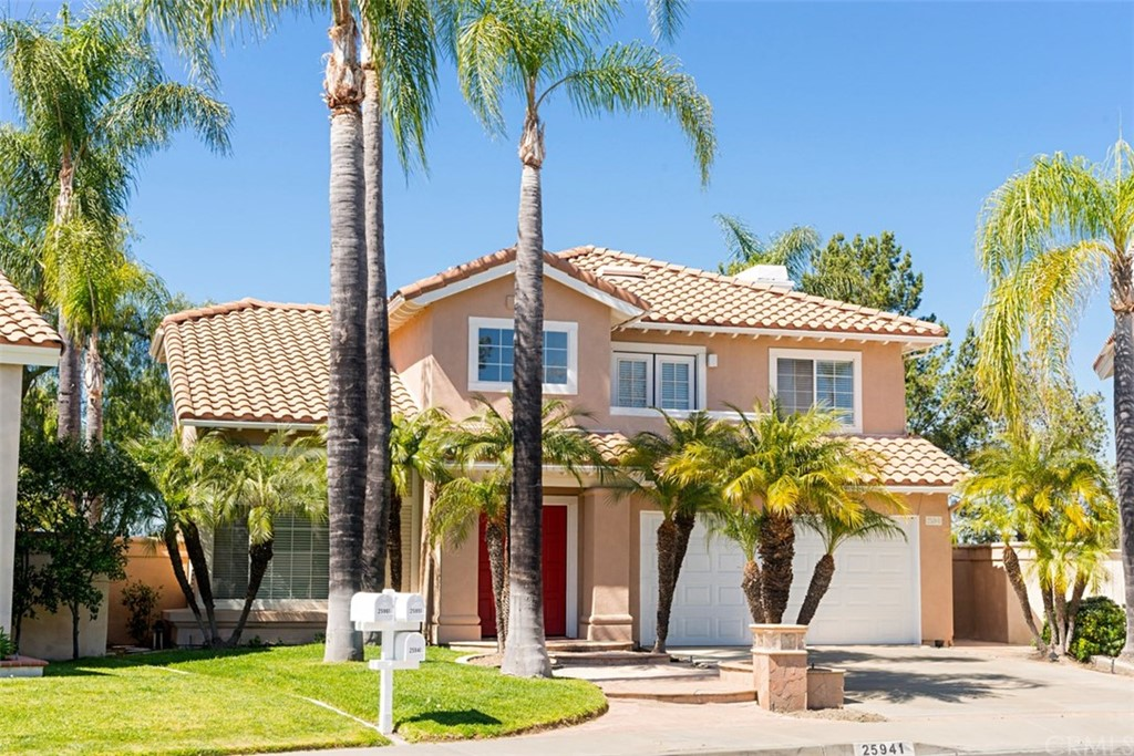 Located in the beautiful Bel Air neighborhood of Califia, this pretty home is nestled on a quite cul de sac street in popular South Mission Viejo. It is conveniently located near award winning Bathgate Elementary School and Community Park, and it enjoys membership in the fabulous Lake mission Viejo Association.  The spacious living area is bright and inviting, and the lushly landscaped yard and patio area offers great outdoor living. Enjoy 3 spacious bedrooms, separate living and family rooms, formal dining room and sunny kitchen with breakfast bar and additional eating area. The kitchen has a gas range, and built-in microwave for a great cooking experience plus a new dishwasher. The romantic fireplace adds to the cozy family room area. The home was  re-piped in 2018. There is lots of custom cabinetry in the garage, for additional storage, plus abundant storage space inside!