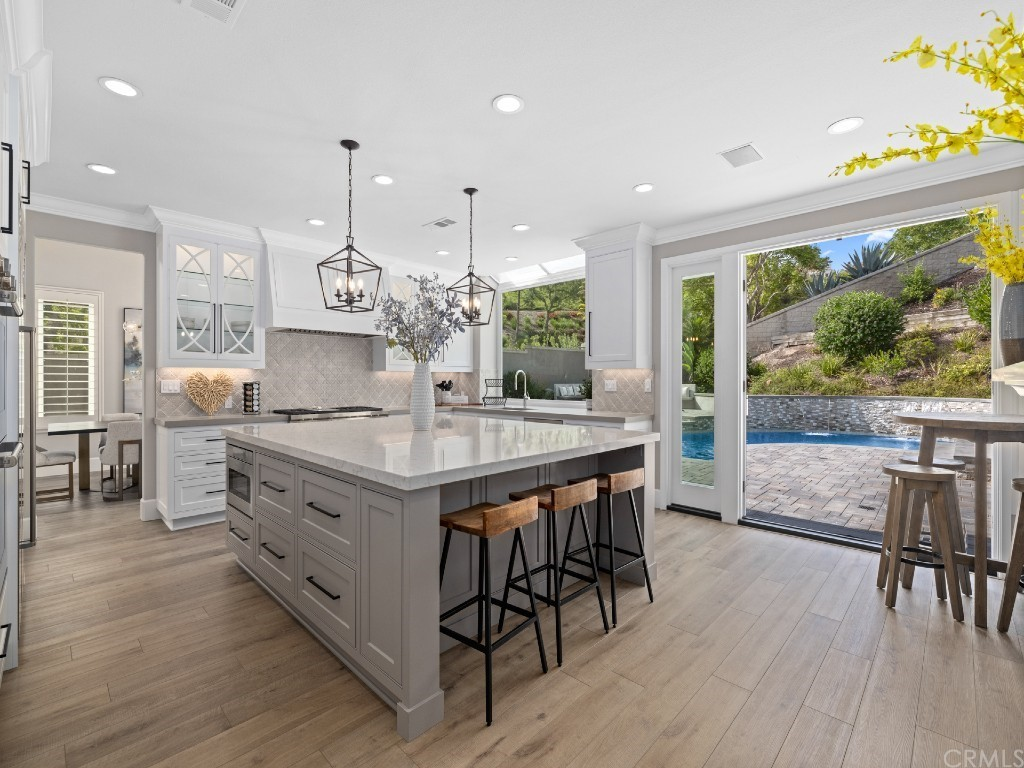 Newly remodeled kitchen with custom cabinetry, generous storage,a large island for mealtime prep and socializing, and pro-level Sub-Zero and Wolf appliances.