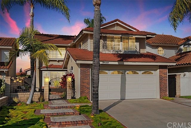Gated courtyard entry, serene front patio, fenced all around, low maintenance exterior, durable tile roof, driveway holds two cars.