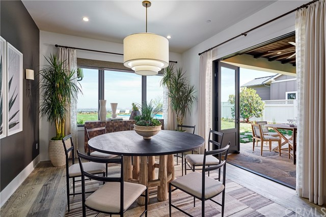 Dining room opens onto the covered patio and backyard. Model home shown, same floorplan.