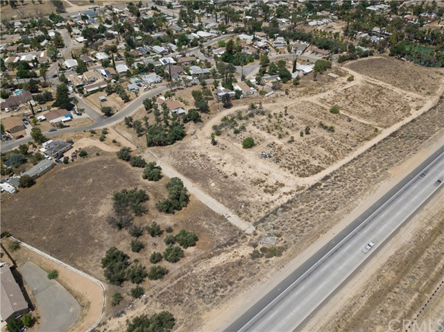 8.98 Acres of Land•I-15 Freeway Frontage•Zoned Rural Residential per City of Wildomar-can be rezoned to medium density residential 5-8 dwelling units per acre (Verify with City)•Water available to Site