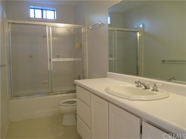 Additional upstair bathroom with bath and shower.
