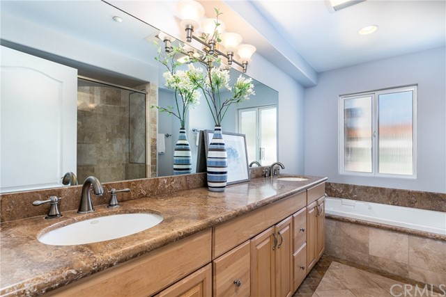 Primary bath has dual sinks and a soaking tub