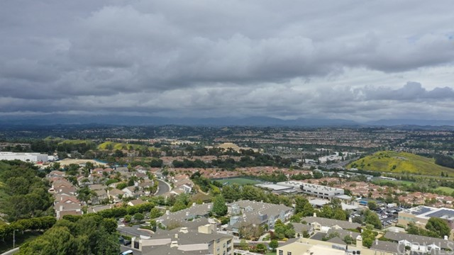 ABSOLUTELY BEAUTIFUL!!! This property is on one of the highest points of Aliso Viejo. breathtaking panoramic view of mountains and city lights where you can enjoy the 4th of July fireworks from several cities. The view is 2nd to none. Turnkey detached home with 3 bedrooms, loft, 2.5 bathrooms, and attached 2-car garage. All bedrooms are upstairs. Newly upgraded kitchen, living room, and dining area. The large living room has a beautiful fireplace.  Spacious master suite boasts same spectacular view and bathroom with roman tub, separate shower, double vanity, and a walk-in closet.  Recent whole house re-piped with 3 stage filtration system. There is no longer any special assessment tax / Mello-roos. New price drop to sell. You won't find this quality home with a view like this anywhere. With this new price, it won't last long, hurry!!!