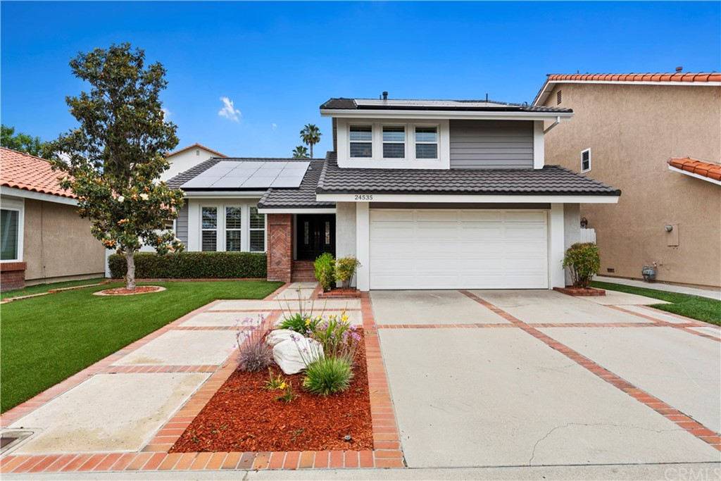 A must see Lake Forest Beauty!This 4 bedroom home has incredible curb appeal with extensive use of used brick,water conserving turf landscaping & modern colors.Insulated siding, pressed metal roof & fully owned solar system.This home is light and bright w energy efficient windows through out. Enter into large living room w cathedral ceiling w exposed beam, light bright paint, neutral carpet & wood flooring.Family kitchen with recessed lighting,eating area,ceiling fan & sliding glass door.Family room with recessed lighting and cozy fireplace.Permitted room addition (4th bedroom/Office) with beautiful knotted wood ceiling, ceiling fan, laminate flooring, many windows, built in shelves & closet.Lg master suite w upgraded baseboard,ceiling fan,mirrored wardrobe doors,closet organizers.Large secondary bedrooms w ceiling fans,mirrored wardrobe doors & closet organizers.Very private terraced back yard w lush landscaping,water conserving turf w plenty of room to entertain.1 year new AC unit & furnace,newer energy efficient windows and Shutters through out.Two car garage w newer garage door opener,built in cabinets & work bench. Member of the Lake Forest II Sun & Sail Club where you will enjoy all the amenities of a country club resort including lake access, tennis courts, 4 pools, a tot lot, sand volleyball, basketball, workout facility, club house and much more. Close to schools, freeway, Toll road & Irvine Spectrum. Low Taxes, no Mello-Roos.