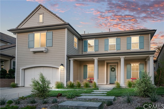 This Hilltop Modern Farmhouse built by the New Home Company gives you a new house with gorgeous upgrades and mature landscaping without having to deal with construction. Situated on a large lot inside the coveted gated community of Marywood Hills, the magnificent property showcases 4,278 SF of interior living space with an open concept floor plan. A large family room includes an upgraded fireplace with remote and leads out to a covered Loggia through accordion sliding doors. The chef's kitchen boasts a built-in fridge, custom cabinets, and top-of-the-line Wolf appliances, including a 6-burner gas range with griddle, 3 ovens, microwave, and dishwasher. A huge extended white quartz island will be an entertainment centerpiece. The first floor bedroom with en-suite and private access is great for guests and multigenerational families. Upstairs, the master suite showcases a wall of windows and an open retreat. The spa bath with a large shower and gorgeous free-standing tub situated ideally under the window completes the master. Secondary bedrooms feature en-suite baths and upgrades. Amenities include beautiful countertops, Walker Zanger tile floors, automatic window coverings with remotes, high-end windows, *SMART home wiring, and more. The finished three-car tandem garage includes a brand-new Rinnai tankless water heater and an electric charging station. Look out the bedroom or loft windows and be captured by amazing views of Catalina, city lights, and beautiful fireworks.