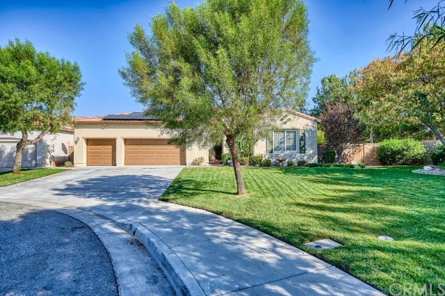 This private single-story, cul-de-sac home in the master-planned community of  Heritage Lake with courtyard, sits on one of the largest lots in the development, just under a 1/3 of an acre! No rear or left side neighbors, just your park-like front yard!  The 5 bedroom, 3 Full bathrooms home must be seen in person. From custom travertine floors and matching tile baseboards in the main areas to the upgraded open concept kitchen opens to the family room, offers granite kitchen countertops and backsplash, double oven including convection,  island with granite dining room table & walk-in pantry.   Large Master-suite and it's recently renovated ensuite master bath!   Soaking tub with waterfall faucet, wood-like tile flooring, wooden shutters, marble shower with shiplap pony wall, and quartz countertops are just some of the many upgrades.   The spacious backyard is perfect for entertaining and has a 70-foot alumawood patio cover that runs the length of the house, concrete, gorgeous landscaping, and Koi Pond. The side yard is a tropical oasis! Heated saltwater pool (with rock slide and waterfall!) & oversize spa will keep you refreshed.  The Home includes a 29 panel paid off solar system.    The Heritage Lake Community Includes clubhouse 2 Swimming Pools, Kiddie Pool, Splash Park, Parks/Playgrounds, Brand New Sports Park, Walking Trails, Baseball & Basketball Courts, Paddle Boating, and Catch & Release Fishing For Residents.   Call for more details!
