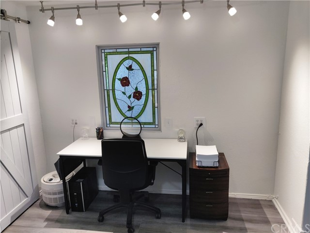 ... office nook with stained glass wall accent