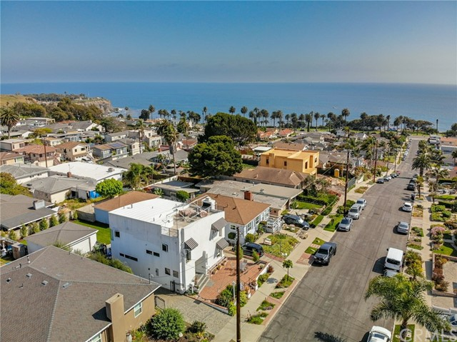 Click icons for drone video & 3D tour. PANORAMIC OCEAN AND CATALINA VIEWS from rooftop of custom home located in sought after Palisades, just 2 blocks to the sea. Enchantingly lit, day or night & unique architectural details thru-out. Dramatic views from roof top deck include spectacular sunsets & sail boats gliding through the waves. On the entry level you will find a chef's kitchen w black granite counters, large island, timeless maple cabinets, & Viking appliances. View the garden thru windows in intimate, yet spacious dining room & enter the entertainer patio & large flat yard from kitchen. Cozy up to the Living Room Fireplace w views to the Sea. On this level you will also find a powder room. Light maple hardwood flooring thru-out. Front patio is a lovely space to watch the sunset. Large, 2nd floor master bedroom retreat w vaulted ceilings features a full wall of reach-in closet AND a walk-in closet + balcony to take in the views. Master en-suite bathroom has travertine tile & counter-tops, whirlpool tub, & large separate shower. 2 addtl bedrooms, laundry & full bath on this level + stairs to rooftop deck. Recently renovated fenced-in back yard has large lawn area, sprinklers & trees offering privacy. Plenty of space to host parties on stone paved patio. Gated and private driveway offers additional parking spaces for boat, RV or several cars and leads to detached 2-car garage. Convenient to shopping, restaurants, Terranea Resort & Trump National Golf Course.