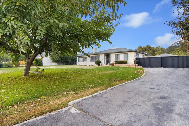 You'll love this spacious, ranch-style home located in Pomona. This home offers approx. 2750 sq. ft. of living sprawling on just under 1/2 acre lot. This home features 4 oversized bedrooms and 3 bathrooms. The kitchen opens to the dining room offering a great opportunity for entertaining both family and friends. Additionally, there's a separate guesthouse/mother-in-law quarters/rental opportunity featuring one bedroom, a living room, bathroom and small kitchen.   This home is close to schools, shopping, restaurants and transportation options. This is a Probate Sale and shall be sold in as is condition with no repairs to be made. Additionally, no termite report or clearance will be provided.