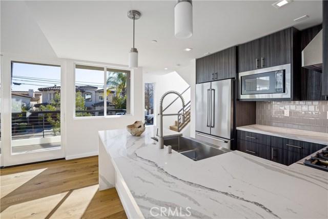 Kitchen with quartz countertops, stainless appliances