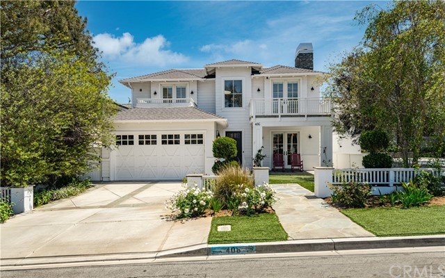 Gorgeous curb appeal with putting green front yard