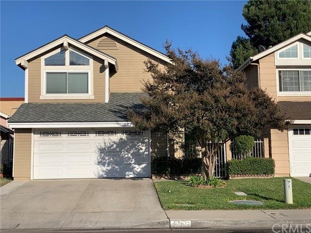Desirable area of  City of Buena Park. Built in 1988. This is a  4 bedrooms, 3 full baths, 2 car garage.  One bed room and 1 bath room down stairs perfect for guests.  As you walk through the gate, the front door is on the side.  Home features bright natural light living room with vaulted ceiling and a fireplace. Large dining room that would fit long table for 8-12 seats. Perfect for entertaining and holiday get together. Kitchen with granite counter top with stools perfect for hanging out. Stainless steel appliances. Behind kitchen are stairs that leads to hall way with rails overlooking the living room down stairs.  2 Nice size bedrooms. A Large Master Bedroom, walk in closet. Master bath with 2 sinks. Enclosed patio currently used as an office. Homes has ceiling fans through out. Tiles floor downstairs easy to maintain. Laminated wood flooring upstairs. Manicured yard with fruit trees.  Owner have a storage shed in the back and will leave it with property. Plenty of storage in garage.  New composition 50 year roof installed in 2021.  Property located near mall, City of Buena Park Civic Center, Police station, churches, stores, Many restaurants near by. Easy 91 and 5 Freeway access.  A must see.