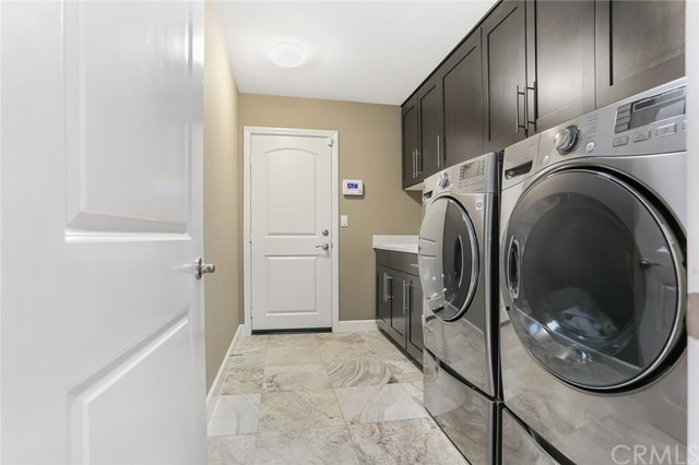 Downstairs Laundry Room and Direct Access to 2 Car-Garage