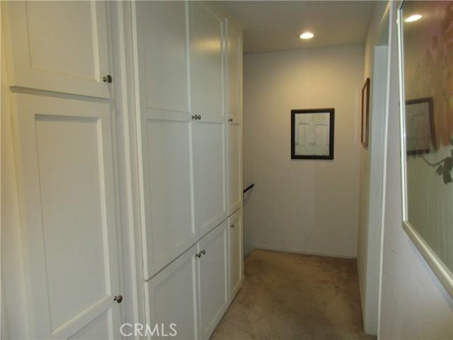Unit #1 Hallway upstairs with storage space.