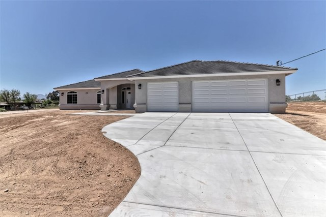 GORGEOUS New Construction situated in Hesperia on over an ACRE lot. Four Bedrooms & 2.5 Baths. Master with Large Closets & Separate Tub & Shower. Separate Family Room w/ F.P & tile flooring. Large Kitchen with with solid surface counter tops, tile flooring, lots of cabinets & large pantry.. Formal Dining, Breakfast Nook, Indoor Laundry & 3 car garage. Photos are actually of similar property. Property is still under construction. ETA is end of October, beginning of November.