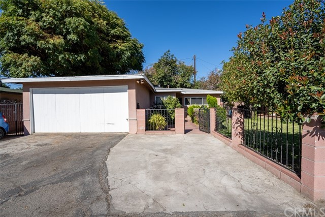 2-car garage with gated entrance
