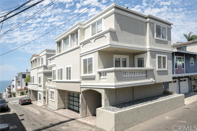 Manhattan Beach living at it's finest. This 2100 sq ft  4 bedroom, 4 bath (3 full & 1 half), ocean view, fully furnished 3 level townhome is located in the perfect setting. Just 2 blocks west of the beach,  & 2 blocks south to downtown Manhattan Beach.  This unique  home offers 6  Parking Spots!  A welcome feature for  your family & friends in a community where parking is a premium. The master suite has a walk in closet, double sink & updated shower as well a balcony and new Tempurpedic king mattress. The 2nd bedroom turned office also has a walk in closet and adjoining balcony to the 3rd bedroom. The 4th bedroom (1st floor) has a Murphy bed to make the space more flexible & has an en suite full bathroom.  The stunning 3rd level living area offers a step up kitchen w/marble floors and  ocean views, new Samsung refrigerator, wine cooler & stainless steel appliances. The separate dining room is elegantly furnished to entertain & the living area boasts maple hardwood floors, fireplace & spectacular ocean & pier views, with  steps to a newly tiled patio.  The garage is fully remodeled w/acrylic floor, cabinets plus a secured  locked storage area for valuables.  Additional features include underground utilities,  copper gutters, 3 level speaker system, wired for ADP security, custom blackout curtains in living room & master bedroom.
