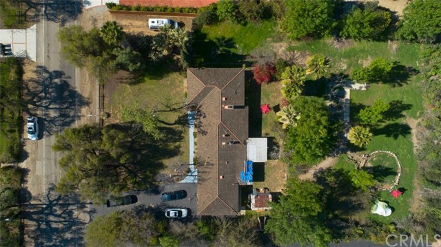 Endless Opportunities for this large flat lot. Home has converted Garages and added Bedroom. Located in a beautiful Fullerton Area and great schools. Buyers to verify square footage of home and lot size. This is one of the largest flat lots in the desirable neighborhood. You may either build a large CUSTOM Home w Guest House of your choice with Tennis Court and/or Pool.  There is a very good possibility of a LOT SPLIT!!!  PLEASE CHECK SHOWING INSTRUCTIONS!!!!