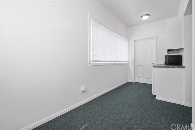 Extra room upstairs, can be used for office, den, has counter with sink