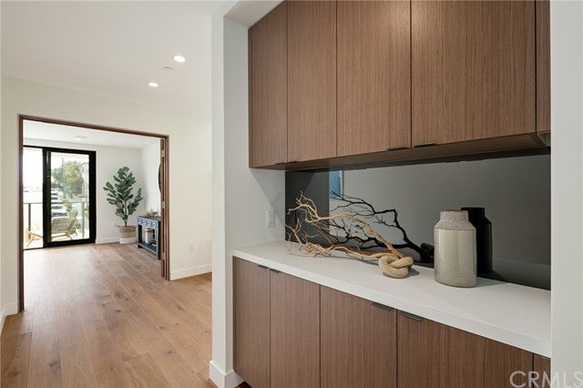 Custom built-ins in hallway ideal for both linen storage and personal display