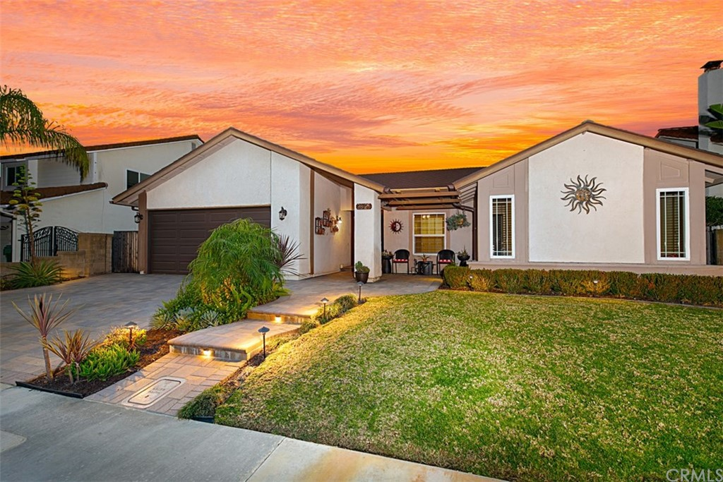 Highly desirable SINGLE-STORY, New Castille home featuring PANORAMIC SUNSET, CITY & MOUNTAIN VIEWS!  It offers 4 BDRMS, 2 BA & is superbly located on a SINGLE-LOADED street. Updated kitchen with butcher block countertops, upgraded cabinetry, recessed LED lighting, tile floors & custom bay window with picturesque views of the backyard. A sliding glass door to access the side yard are all part of the charm of the kitchen. The inviting family room is open to the kitchen & dining area with a warm fire & ice fireplace, ceiling fan. The living room is spacious in size, has vaulted ceilings, dual-pane windows with views of the backyard. The dining room area has a slider that allows for easy access to the backyard & has a custom cut out that peeks into the family room, adding to the unique character of the home. The private master features a large closet, ceiling fan & a slider to the back. The master bath has an updated vanity & walk-in shower. Additional three bedrooms come complete with closets & ceiling fans.  Delight in the backyard w/breathtaking SUNSET VIEWS while entertaining this summer, swimming in the pool or relaxing in the spa with friends & family.  Convenient motorized awning provides shade for those extra sunny days.  A 2-car attached garage has attic & plenty of storage & built-ins.  Mission Viejo perks include the lake, with fishing, sailing, summer concerts w/SPECTACULAR FIREWORK shows!  Enjoy hiking trails & the Jeronimo Open Space Park. Low HOA & no Mello Roos.