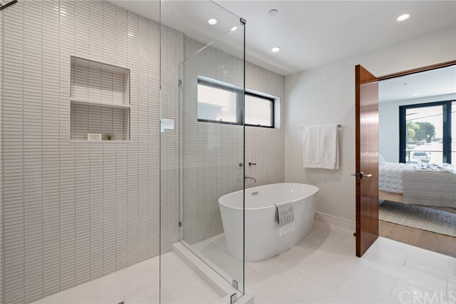 High style Master bath retreat with deluxe soaking tub and spacious walk in shower