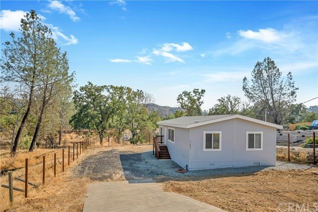 BRAND NEW manufactured home on CacheCreek! This 3 bed / 2 bath home has 1,057 SF sitting on nearly a 1/2 acre parcel! Open concept floorplanwith a desirable layout where the master is separate from the 2 additional bedrooms. Kitchen offers new Stainless Steel appliances including a propane range & refrigerator. Large indoor laundry room off the kitchen is a bonus! Each bedroom offers a ceiling fan and the master has an oversized walk-in closet. The exterior has room to add a garage or create your dream landscaping! Imagine fishing from the creek or simply enjoying the sounds of water from your very own backyard. A solid wood fence will be installed prior to closing, great for keeping in the kids or pets and to ensure privacy! Brand new septic system is a bonus! A short drive into town offers shops, restaurants, post office, coffee, schools and more. This turn-key and affordable home is the cream of the crop!