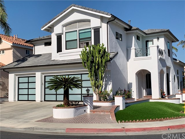 Welcome to the prestigious gated community Park Solano!! This beautiful home has been completely rebuilt in 2018 by talented architects in a sophisticated design. The home has been remodeled with a new roof, new pluming,new air conditioner, new water heater, new kitchen cabinets with quartz countertops and all new appliances. This home has a 3 car garage with direct inside access. In addition there is also a custom-designed cabinet on the wall and the flooring is finished in epoxy. There is a spacious kitchen island with wine coolers and built-in glass cabinets. The windows next to the living room,kitchen,and patio doors are installed with roller shades that open and close with a remote control, and a barn door is installed on the wall entering the kitchen from the living room to create a wall-like effect. Downstairs there is a bedroom with a full bath, which is perfect for overnight guests. The master bedroom on the second floor has a luxurious double sink, shower and walk-in closet. There are also two spacious bedrooms with one full bathroom, and a den that can be used as an office.This house is installed separate new air conditioners,the first and second floors. This home has two cozy fireplace at family room and master bedroom. Directly outside is a well-maintained backyard with a beautiful custom built Gazebo. There are beautiful parks and many shopping/dining options nearby. Great school districts such as Oxford Academy and Cypress College. Low HOA & No Mello Roos.