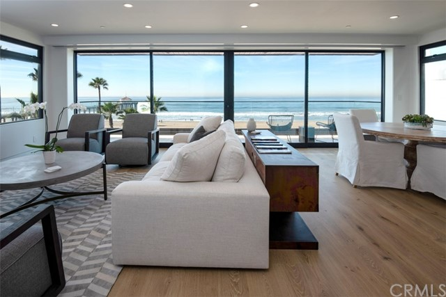 An incredible opportunity to live directly on The Strand! This upgraded, modern unit provides unobstructed views of the ocean as far as the eye can see. Only a few feet to the sand with the Manhattan Beach Pier in the near distance, this extensively remodeled unit boasts high-end finishes throughout. As you enter, the bright and open floorplan guides your eyes straight through the double sliding glass doors directly to the ocean. The elegant living room with dining area steps out onto the balcony with amazing panoramic views which is elevated above The Strand providing added privacy. The well-appointed kitchen features bar seating, Wolf range, custom cabinetry, and Carrara marble back splash. The main suite includes dual closets and a sophisticated bathroom with tiled walls and glass shower. Additional second bedroom with natural light and designer guest bath. This is 1 of 3 units in a newly remodeled building. Relish in the added features of a two-car garage, in unit laundry, AC, secured entrance, dual pane windows, and wood plank flooring. Enjoy warm ocean breezes in this refined condo in the Sand section of downtown Manhattan Beach. Be a part of a vibrant oceanside community with boutique shops, acclaimed eateries, and a true local feel.