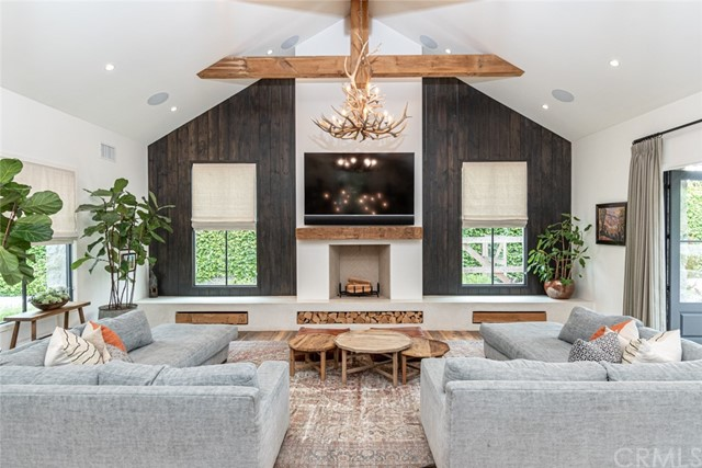 This turnkey single level Eric Olsen designed home, built by KRS in 2016 in a rustic modern farmhouse style, is situated on a ½ acre private lot and blends comfortable living spaces with the modern touches desired in today's newer homes. The home features 4 bedrooms, 4 baths, an office plus a detached barn that has been renovated for use as a versatile bonus/entertainment space complete with wet bar, multiple TVs, couches and games. Additionally, a pristine Airstream trailer is included in the yard for use as a unique guest house. The center of the home is the large chef's kitchen with Carrera marble countertops and 13 foot island, Blue Star dual ovens, Thermador cooktop and full-size Sub Zero refrigerator. The master suite includes a fireplace, soaking tub, oversized shower and walk-in closet. Three additional bedrooms plus a home office are located down the hall from the master suite. A large laundry room and mudroom provide ample storage. The two guest bathrooms maintain the farmhouse style with schoolhouse and farmhouse sinks plus custom reclaimed hardware. Recent upgrades include a beautiful pool and spa, outdoor shower, outdoor fire pit under the covered loggia, and built-in BBQ. The oversized lot offers completely refreshed landscaping with producing fruit trees and raised vegetable planters, a generous grassy area, long driveway with room for several cars and toys plus a built-in basketball hoop. A covered stable plus a working chicken coop complete the yard. Numerous architectural details in the home include soaring 20' wood beamed ceilings, stonewalls, reclaimed barn wood floors, custom lighting and window treatments. Additional amenities include a high end AV system, HVAC plus water filtration system. Perfectly situated close to the Back Bay Nature Preserve walking and biking paths and easy access to the 73 Freeway and John Wayne airport. The home is being offered fully furnished and is perfect for year round enjoyment of the Newport Beach climate.