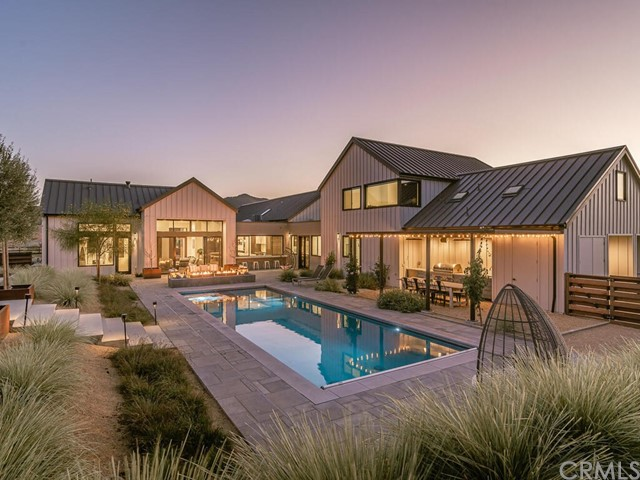 Fabulousresort-like property with vineyard views and a modern farmhouse aesthetic constructed only 2 years ago! Enter the gated Jespersen Ranch to find this exquisitepropertyboasting a 4,645 sf main house with 4 en-suite bedrooms, bonus suite, pool and spa, detached gym, and detached guest house. Upon entry you will find light-washed wood flooring leading you through the foyer to a vaulted and beamed ceiling of the great room and kitchen. Highlights include a gas-burning fireplace, large island with fountain countertop, high-end appliances, black-framed windows and sliding doors to the outdoors, and spacious dining area with entertainer's bar and butler's pantry. The owner's suite is privately situated on its own side of the home with a 2-way gas fireplace and patio, dual closets, and grand bathroom with tub, seamless shower, modern chandelier and access to the pool area. All of the guest bedrooms feature their own en-suite bathrooms and walk-in closets for the utmost comfort. Venture upstairs past the expansive mud room with laundry to find the spacious bonus suite with bath, wet bar, storage room, and views. Located off of the entry pathway sits a beautifully designed 600 sf detached guest house with bedroom, bath and kitchenette. This fully equipped property also features an outdoor the dining area with kitchen, bocce court, animal pen, water fountain and outdoor fire pit, fully fenced yard, veggie garden, lawn, solar, and Tesla chargers and Tesla back-up batteries.