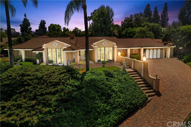 ONE-OF-A-KIND CUSTOM SINGLE STORY IN SUNNY HILLS ESTATES! Beautiful Fullerton home with a POOL on a spacious 20,687 Square Feet lot, .48 acres! This home sits above the street which provides a corner lot with lots of privacy. Upon entry, you are greeted by the inviting formal living room with cozy fireplace and formal dining room both have large sliders with beautiful views of the front landscaping and neighborhood. Easy access from the Front Entry to the Home Office. Kitchen features plenty of cabinetry for storage, stainless steel appliances, double oven, microwave, beautiful granite countertops, pantry, counter bar with seating and is open to the sunroom and family room. LARGE family room with cozy fireplace, STUNNING view of the backyard and sparkling pool with extra large slider that leads out onto the patio. Spacious Master Suite features LARGE walk-in closet, glass slider with beautiful view of the backyard. Additional bedrooms are large and come with their own spacious closets. Large Workshop is sized for future 3 car Garage. This backyard is a dream! This backyard is perfect for entertaining and ready for your next BBQ! This backyard features BBQ island with covered patio, several patio areas for seating, beautiful sparkling pool, beautiful mature landscaping. Walking distance to Laguna Rd Elementary and Park, close to restaurants, shopping, parks and entertainment. Award Winning Schools: Sunny Hills High School, Parks Middle School and Laguna Road Elementary. Welcome home!