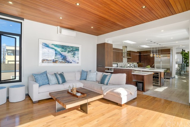 Sunny Family Room off of the kitchen- opens onto deck- bringing the outside in.