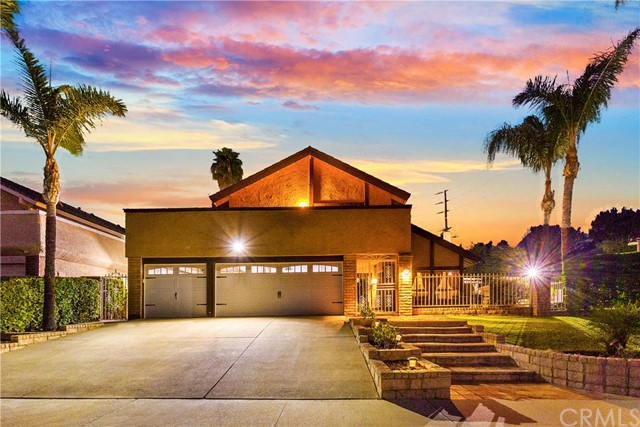 Welcome to 839 Woodcrest Avenue, in the City of Brea.  This Charming Home is Located in a Lovely Tranquil Neighborhood that is Perfect for Raising a Family. Home Features Include, 5 Bedrooms, 3.5 Bathrooms, 2,529 Sq. Ft. of Interior Living Space, a Large 10,292 Sq. Ft. Lot, it was Built in 1976, and it has a 3 Car Attached Garage.  Enter Through the Home and be Greeted by a Spacious Formal Living and Dining Room with High Ceilings.  The Living Room has a Warm and Cozy Fireplace and Both Living Room and Dining Room has Laminate Flooring.  In the Dining Room there are two Sliding Doors that Lead to the Back and Side Yards.  Enjoy Preparing Warm Meals in a Spacious Remodeled Kitchen with a Full Range of Kitchen Appliances, Granite Countertops with Center Island, and a Pleasant View of the Private Backyard from Your Kitchen Window.  In Addition, Next to the Kitchen there is a Family Room with Laminate Flooring and Sliding Door that Leads to the Backyard.  There is an Additional Cozy Living Room with Kitchen next to the Main Floor Bedroom.  In the Exterior You will Find a Spacious Front Porch, a Large Wrap Around Balcony of the 2nd Floor Master Bedroom, and an Easy to Maintain Back and Side Yard with Pavers.  There is a Large RV Parking Area on the Side of the House.  Offering the Ultimate Desired Private Setting, Appreciate Tranquil Living that this Neighborhood has to Offer.