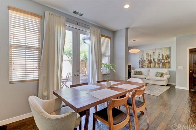 Dining room features glass doors that lead out to the large, private patio/yard - perfect for entertaining
