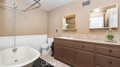 old fashioned bathroom with claw foot tub