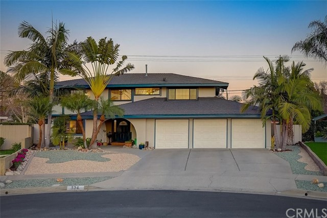 Beautiful four-bedroom home features ALL NEW white bright and neutral interior paint, recessed lighting, upgraded Laminate Plank Flooring and carpet. Enter the spacious living room with step down dining area and large windows that allow an abundance of natural light to illuminate the open floor plan. The remodeled kitchen impresses with gorgeous oak cabinets, granite counter tops and stainless steel appliances. Enjoy the family room with brick fireplace, built-in bookshelves and a breakfast bar countertop. The extended room is perfect for an office/school area. The half bathroom and 3-car garage with direct access complete the downstairs. Up the stairs to the primary bedroom is an ensuite full bathroom, mirrored closets and a sitting area that leads to a private balcony. The spacious secondary bedrooms with new ceiling fans share a full bathroom down the hallway. New textured ceilings, electrical switches, outlets, doors and door knobs. The spectacular backyard is professionally landscaped with 50+ palm trees of 9 varieties, a covered patio, gorgeous Pebble Tech pool with safety gate, cool decomposed granite – perfect for entertaining. Low drought front yard with open porch, new exterior paint and trim. Epoxy coated copper plumbing, dual Air Conditioning System, Dual Pane Windows. Nearby shopping, dining, parks and award winning schools. Must SEE the SUPPLIMENT for more property upgrades and feature.