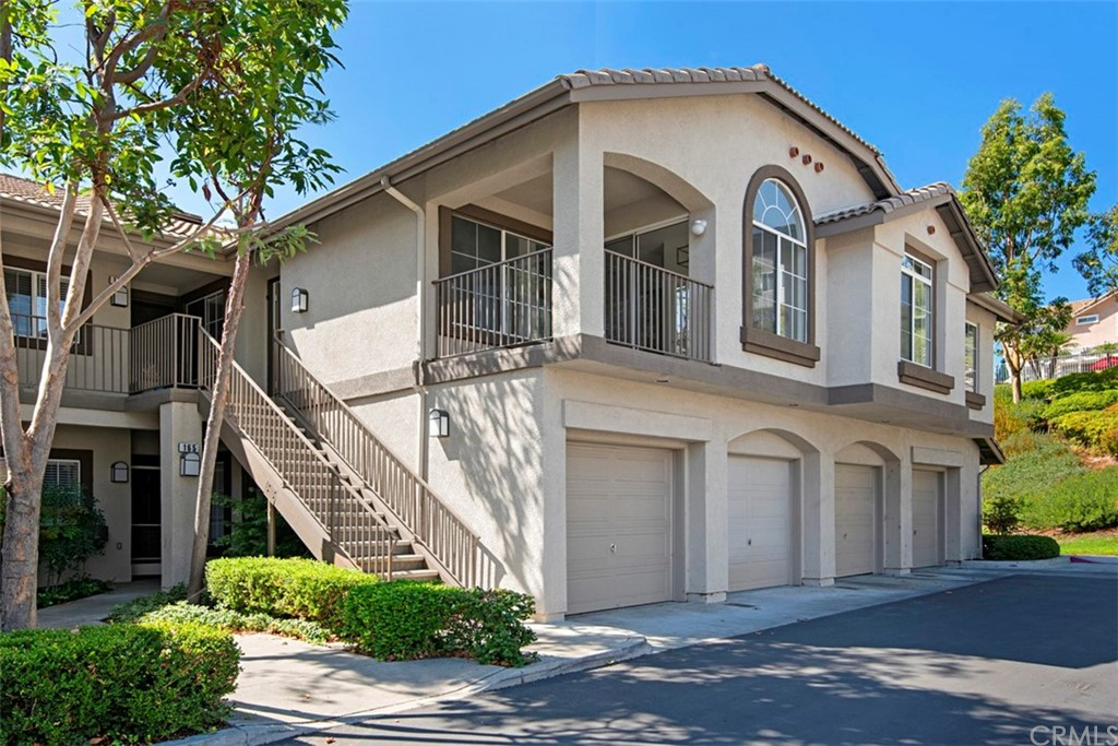 READY FOR YOU TO MOVE IN TODAY!! This recently upgraded, beautiful Condo located in the Upscale hillside community of Foothill Ranch is located at the back of the development in a quiet location on the Top Level with no one above or below. There is a large greenbelt and plenty of additional parking nearby. The home features Mountain views, 2 Spacious Bedrooms and 2 full Baths, Vaulted Ceilings in the Living Room with a Cozy Fireplace, a large open kitchen recently updated with quartz counters, Double Sink, Newer stainless steel Dishwasher, Oven, Stove, Microwave and Refrigerator are included. The large Windows and Sliding Glass Door that opens to the Private Balcony allow plenty of natural light. The Master Bedroom has a Large Walk-In-Closet and Private Bathroom. The laundry closet has additional storage and room for a full size washer/dryer. Neutral paint with easy care High grade Vinyl flooring that looks like wood throughout the home. There is a Single Detached Car Garage with Extra Deep Space and Plenty of additional Parking around the complex. This is the perfect location with hiking and biking trails nearby, wilderness areas such as the Borrego Canyon Overlook and Whiting Ranch Wilderness Park, and Lake Forest Sport park; yet close to Irvine Spectrum work area and 241 Toll Roads. Saddleback USD including award winning Elementary School. Community amenities, include a pool, spa and BBQ area.