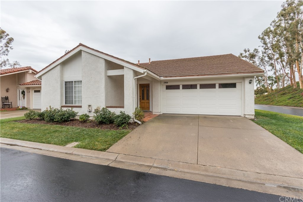 Located in the Beautiful 55+ Community of Casta Del Sol, this spacious, single level home is move in ready! You will be greeted by a beautiful wood front door with decorative glass inserts. Some notable features you will immediately notice are the brand new neutral paint throughout, scraped ceilings, hickory designer laminate flooring and dual pane vinyl windows. There is a spacious bedroom with generous closet space in the front of the house and an adjacent smaller room that would make a perfect office, featuring a slider that leads to the side yard. Also nearby is the homes first full bathroom with a step in shower. The large living area features a statement brick fireplace and has plenty of natural light both from the beautiful windows as well as from the large skylight above. Large sliders will lead you out onto the brick patio space to enjoy that beautiful sunshine. Entertain guests in the spacious dining room immediately adjacent to the clean and neutral kitchen. The roomy master suite allows plenty of natural light in and has a tall vaulted ceiling. Arched doorways will lead you into the generous mirrored closets and bathroom. The vanity provides ample storage and is clean and neutral. The home was repiped in September. Also equipped with a steel roof and a whole house fan in the attic for those warm summer months. Attached 2 car garage with built in storage and workbench. Home is a member of the Lake Mission Viejo Association. Home has been virtually staged.