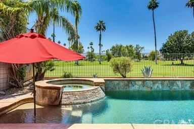 PRICE REDUCTION: Motived Seller. Stunning 2 bedroom /2 bath on golf course. Pool/Spa, outdoor kitchen, barbeque and bar. Turnkey and fully furnished, completely updated appliances and decoration. Walking distance to El Paseo, quite neighborhood, mountain views. NO HOA. (Attached) Single Family Residence. Great seasonal rental property, (over 30 days). Come enjoy the fun in the sun.