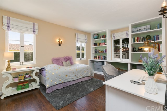 Second Bedroom with Hardwood Floors, Open-in Wood Windows, Built-in Shelves and Wall Sconces