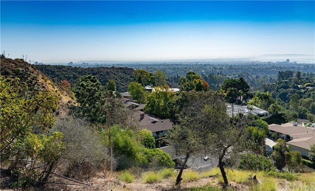 One unique opportunity to build a new custom home in this incredible 13,664 sf.(A)  row lot in Pacific Palisades.   Exclusive breathtaking panoramic ocean , city and hillside views with no roof top interference.   Surrounded by luxury estates.  Homes in the area range from 3mil to 6 mil. This lot has endless development potential.   Ideally located about 2.7 miles from Palisades Beach Club and  about 3.7 miles to Will Rogers Beach.