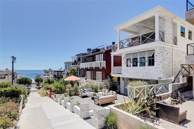 229 8th Street is a collective blend of builder talent, design experience, and beach-living inspired architecture. Designed by Waterleaf and executed by TriWest while being located in a bullseye location with simple access to downtown Manhattan Beach, the pier, and the water make this home a true gem. This walk street home has south facing exposure which is favorable for more sun and has big views with open simple living spaces with a neutral design palette. In the heart of a classic coastal neighborhood, this location is a nucleus for family and friends. Relaxed but refined, crisp but inviting, the casual elegance of this purposeful environment embraces an active beach life where sun, sand, ocean breezes, and memories are closely interwoven.