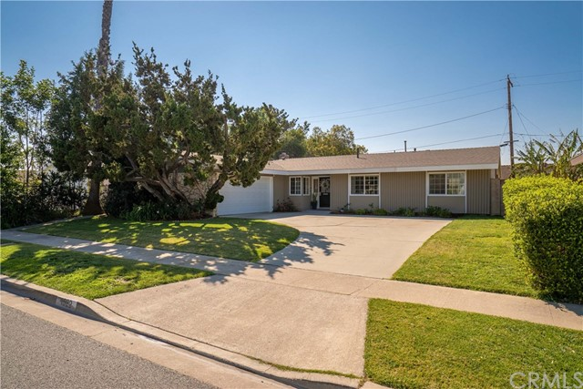 Nested in the heart of Tustin where pride of ownership is prevalent, enjoy a friendly neighborhood and nothing short of the highest quality in craftsmanship with a host of upgrades sure to please. With an inviting curbside approach, embrace the relaxed feeling in this home's open floor plan comprised of 2,325 square feet with four bedrooms and three updated baths. Create culinary masterpieces in the chef's kitchen with an island, granite counters and stainless steel appliances. Relax in the comfortable living room warmed by a fireplace or entertain in the dining area enhanced with shiplap walls.  Beautiful wood floors flow throughout the home while multiple windows and doors surround the home, creating an indoor and outdoor feel with natural light. The private master retreat adds to the home's appeal and boasts a generous walk-in closet, spa-like bathroom, a separate heating / AC unit and patio doors to access the backyard complete with a covered patio, grass lawn and lush gardens, ideal for year-round outdoor enjoyment. The finished two car garage offers storage cabinets, an access ladder and epoxy coated floors.  Ideally located to schools, shopping, restaurants, freeways and Old Town Tustin, this turn-key beauty won't disappoint!