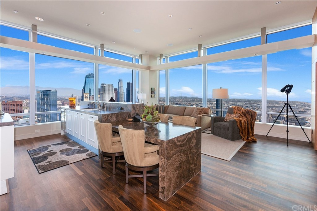 Kitchen and family room with sweeping of Downtown LA and the Hollywood Hills