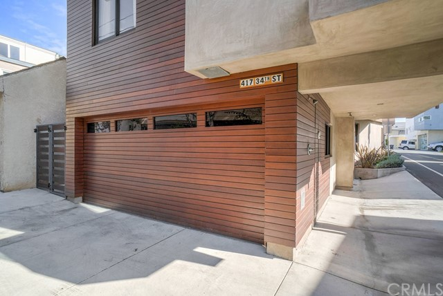 Garage has two doors, one pictured here, the other on the alley, plus a parking spot on the alley. Great spot for guests!