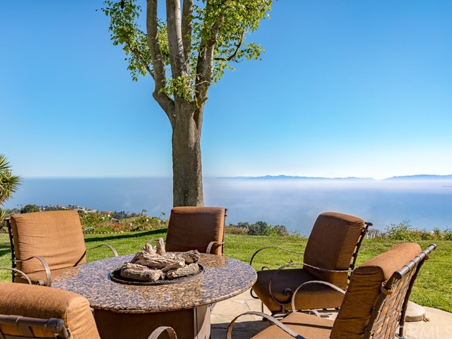 The best view on the Peninsula! Ocean - Catalina - Golf Course. This extraordinary home sits on one of the few coveted view lots located at the top of Ganado Drive. The street level location offers the best position to take in all of the California coastline. The open floor plan was created by removing all the interior walls that open to the view creating the ultimate great room. The home boats a remodeled gourmet kitchen with center Island engulfed in granite and a multi-layered travertine backsplash.  A wall of glass allows the outdoors to surround the interior living area that will impress any friends or guests. A step down family room is equipped with a surround music and theater experience. The master suite is situated on the view side of the property enjoys a remodeled bath and numerious upgrades. Ocean vessels of all kinds will dazzle the eyes while migrating whales & dolphins capture the imagination. Red-tail hawks & local owls will also amaze. A new solar system was just bought and paid for, nearly eliminating a monthly electricity bill. The rear grounds are truly one of a kind with massive grass area complimented with a stone patio lined with mature palm trees. Homeowners enjoy some of the best schools in the country as well as access to some of the best parks and hiking trails on the peninsula. There are simply too many features to list! You have to see it to appreciate.