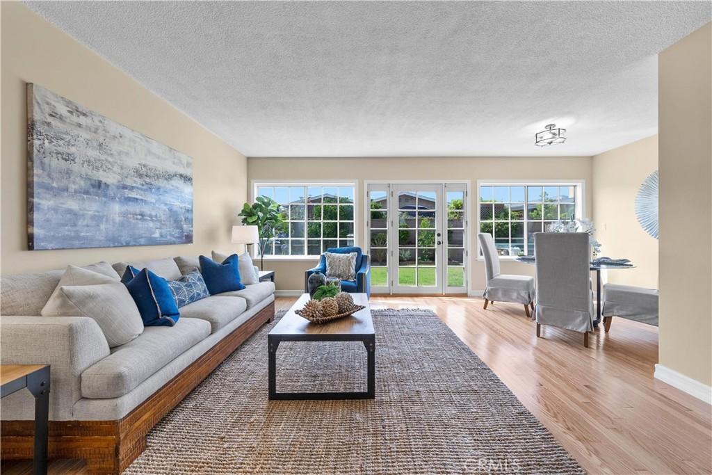 South facing windows illuminate the living room as you enter the home