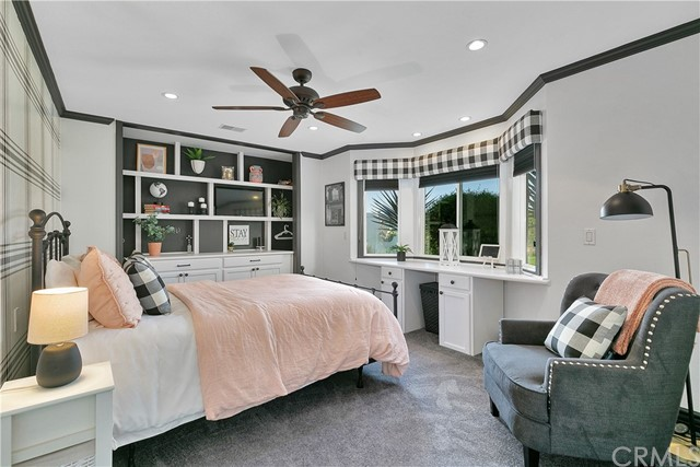 A smaller second master suite with bay window.